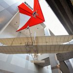 The 1911 Glider fittingly beside the Rogallo Hang Glider in the museum atrium. The 1911 Glider soaring record lead to the aviation sport of soaring including hang gliding, sail planes, ultralights, and paragliding.